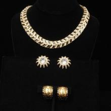 St. John gold tone, crystal and black enamel link collar choker necklace with two pairs of coordinating earrings.