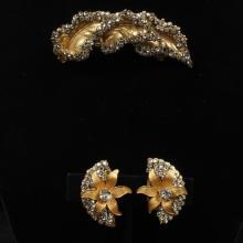 Miriam Haskell rhinestone encrusted gold tone leaf pin / brooch and gilt earrings with floral and feather motif.