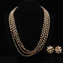 Miriam Haskell four strand faux pearl, amber glass bead and gold tone metal necklace and cluster earrings.