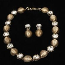 Nettie Rosenstein sterling silver vermeil textured bubble and large rhinestone choker necklace and clip earrings set.