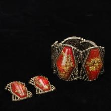 Unmarked vintage costume jewelry 2pc.; wide gold tone, orange and gold flaked acrylic chunky panel cuff / bracelet & earrings.