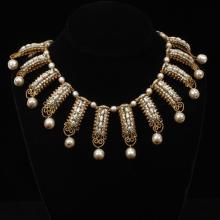 Miriam Haskell gold tone drop collar with suspended faux Baroque pearls, crystals and faux seed pearls.
