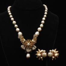 Miriam Haskell faux pearl and crystal gold tone necklace with floral embellishments and multi colored pearl and gold tone earrings.