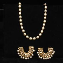 Miriam Haskell faux pearl and metal bead necklace and large horseshoe shaped faux pearl and crystal earrings.