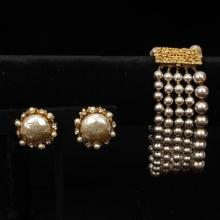 Miriam Haskell multi strand pearl and gold tone bracelet and clip earrings with pearls and crystals.