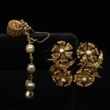 Miriam Haskell gold tone, faux pearl and gold tone filigree bracelet and earrings.