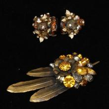 Vendome pin and earring set with metallic feathers, jeweled floral clusters and leaves with citrine and amber glass beads and rhines...
