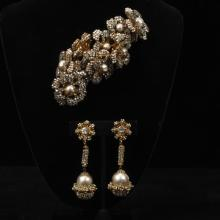 Large Miriam Haskell faux pearl, pave crystal, and gold tone floral pin and dangle clip earrings.