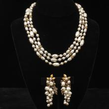 Miriam Haskell faux Baroque pearl, brass bead and crystal three strand necklace with trailing earrings.