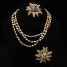 Miriam Haskell set of gold-tone and faux pearl necklace and two pins.