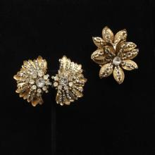 Miriam Haskell gold tone, faux pearl and rhinestone floral pin and earring set.