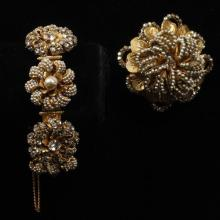 Miriam Haskell gold tone crystal faux pearl and seed pearl floral bracelet with large coordinating pin.