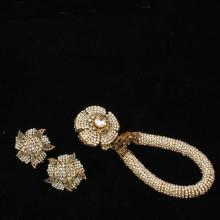 Miriam Haskell faux seed pearl and crystal rope bracelet with drop flower medallion and floral earrings.