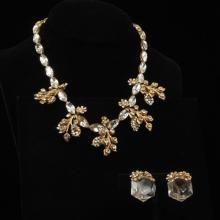 Miriam Haskell gold tone and crystal bib necklace with trailing leaves & large acrylic crystal clip earrings with gold tone flowers.