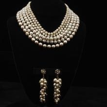 Miriam Haskell graduated six strand faux pearl collar necklace and floral waterfall drop clip earrings.