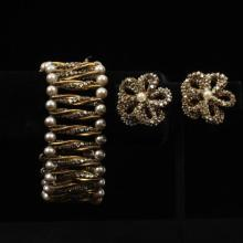 Miriam Haskell gold tone faux pearl and rhinestone cuff bracelet and floral earrings.