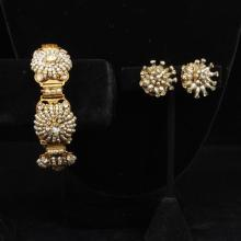 Miriam Haskell gold toned seed pearl and rhinestone encrusted floral bracelet and earrings.