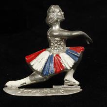 Olympic champion Sonja Henie red, white and blue enamel figural ice skater novelty pin brooch, 1930s.
