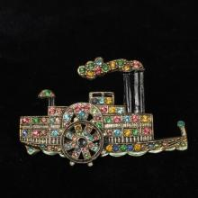 Vintage Riverboat figural pin / brooch; gold tone, enamel, and pastel rhinestone encrusted with moveable steam boat paddle wheel.