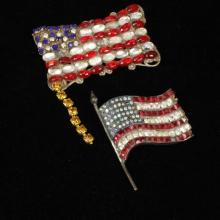 Two patriotic red, white and blue rhinestone and jelly cabochon American flag pins / brooches.