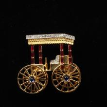 Trifari Alfred Philippe sterling vermeil jeweled surrey carriage brooch with mechanical wheels, 1944.