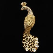 Trifari gold tone peacock figural brooch pin with pave and diamante rhinestones.