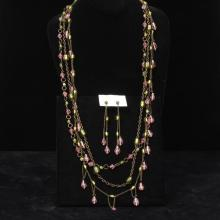 Multi strand chain necklace with green and pink poured glass drop beads with matching pierced earrings.