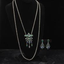 Hollycraft silver tone double strand necklace and chandelier earrings set with green and blue rhinestones.