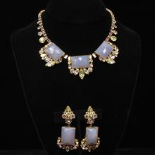 Vintage Ballet gold tone demi parure; choker bib necklace and clip drop earrings with large square pink opalescent stones and irides...