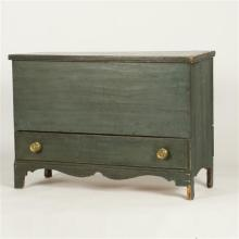 American primitive blanket chest with blue paint, one drawer below over bracket feet.