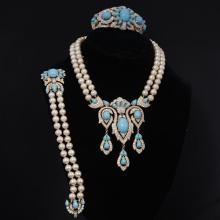 Gorgeous Crown Trifari Jewels of India 3pc. Parure; set with pave rhinestones turquoise glass cabochons and faux pearls.