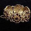 Victorian / Edwardian brass & garnet crystal medallion bracelet.