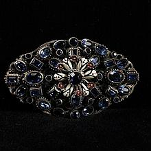 Austro Hungarian jeweled and enamel floral brooch with sapphire blue faceted crystals on silver filigree.