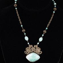 Czech Art Deco Necklace; embossed brass with jade color Peking glass pendant and beads.