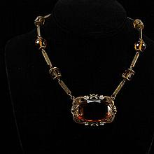 Austro Hungarian Revival Art Deco brass and topaz color crystal necklace with floral enamel.