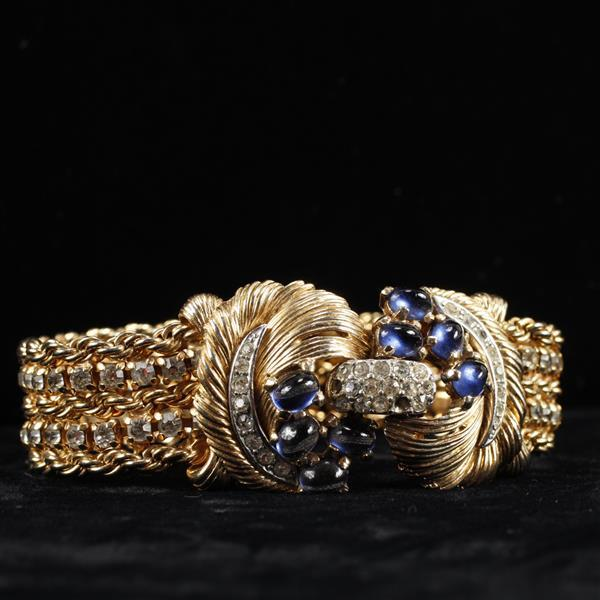 Boucher Chain Wrap Faux Knot Bracelet with Pave Rhinestones & Blue Sapphire Crystal Cabochons.