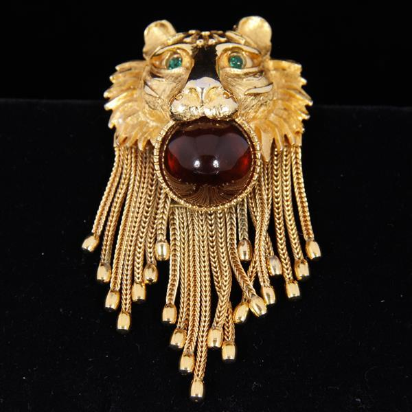 Pauline Rader Gold Tone Lion Head figural brooch pin with glass cabochon and chain fringe.