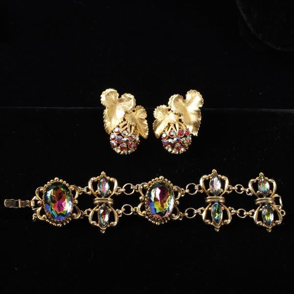 Schiaparelli 2pc. aurora borealis gold tone bracelet and clip earrings with gilt leaves.