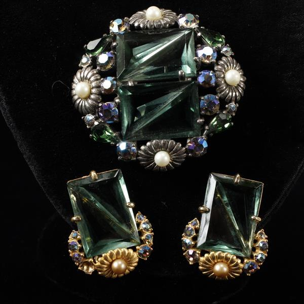Schiaparelli 2pc. co-ordinating invisible set green jewel pin brooch and clip earrings with faux pearl embossed flowers.