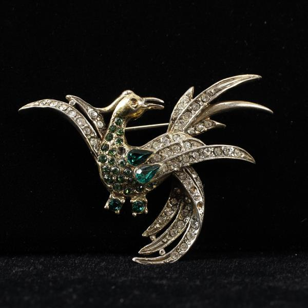 Schiaparelli Sterling silver Vermeil Bird of Paradise figural pin brooch with Emerald diamante stones.