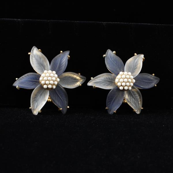 Schiaparelli large poured frosted glass starburst flower earrings.