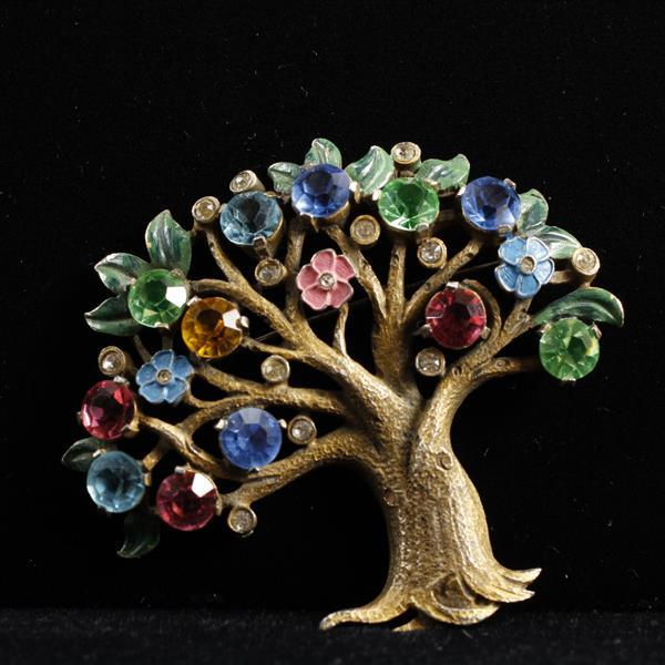Vintage 1930s gold tone jeweled colorful flowering tree pin brooch with enameled leaves and flowers.