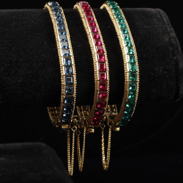 Ciner 3pc. set Jeweled Gold Tone Tennis Bracelets; ruby red, emerald green and sapphire blue crystals.