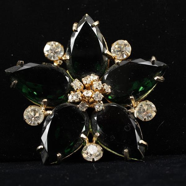 Vogue Jewelry Star Flower pin brooch with large emerald green jewels and rhinestones.