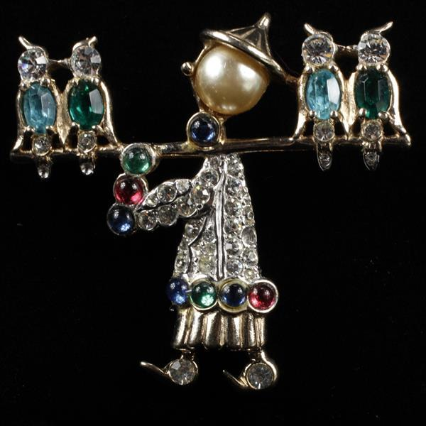 Halbe Figural Pin Brooch; Asian figure carrying birds with multi color cabochons, rhinestones, and pearl.