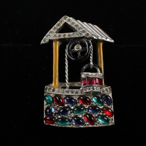 Unsigned Wishing Well Brooch Fur Clip designed by Larry Winters, 1939, enameled with red, blue, & green Jelly Cabochons