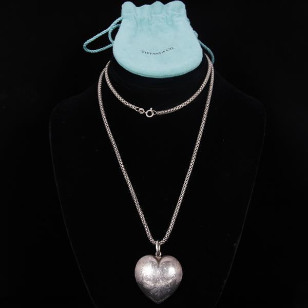 Tiffany & Co. Sterling Hollow Heart Pendant With Engraved Decoration on long 925 Sterling Chain.