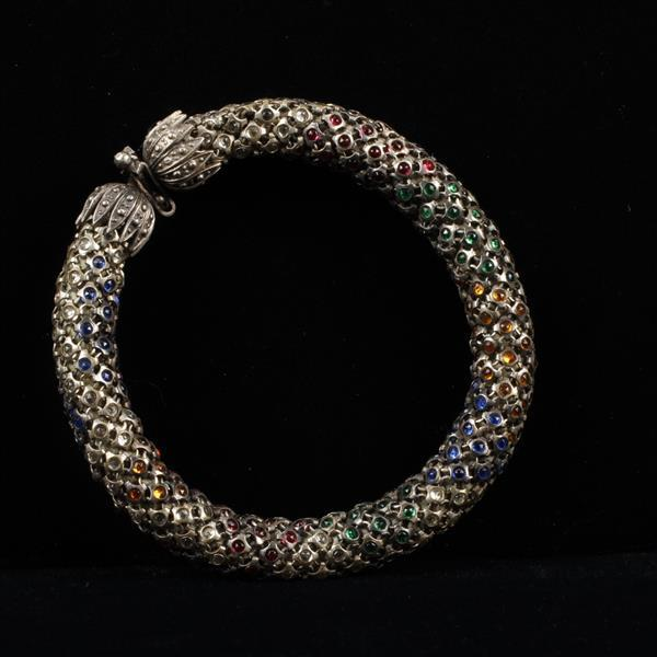 French Art Deco Jewel Encrusted Thick Silver Mesh Snake Bracelet with allover multi colored cabochons.