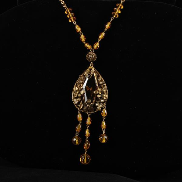 Czech Art Deco Necklace; layered brass filigree medallion with large amber crystal jewel and glass faceted beads on tassel and chain...