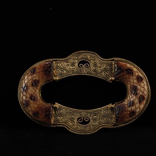 Antique Art Deco Czechoslovakia carved celluloid faux snakeskin brass filigree brooch.